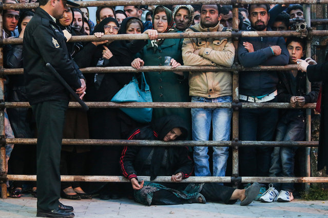 The mother of an Iranian man Balal (C), who killed a fellow Iranian Abdolah Hosseinzadeh in a street fight with a knife in 2007, asks for the family's forgiveness as her son is brought to the gallows during his execution ceremony in the northern city of Nowshahr on April 15, 2014. Samereh Alinejad, the mother of Hosseinzadeh, spared the life of Balal, her son's convicted murderer, with an emotional slap in the face as he awaited execution prior to removing the noose around his neck. (Photo by Araash Khamooshi/AFP Photo/ISNA)