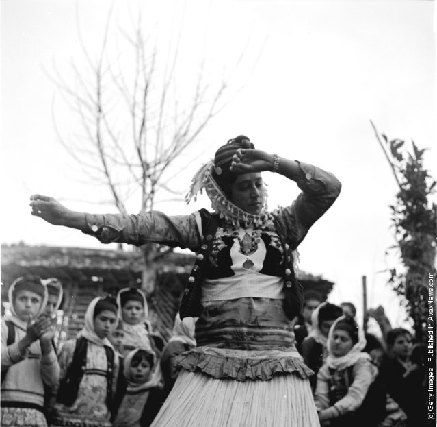 1952:  A villager from the Mazanderan province in north Irannear the Russian border performing her Mohammedan dance during a wedding festival