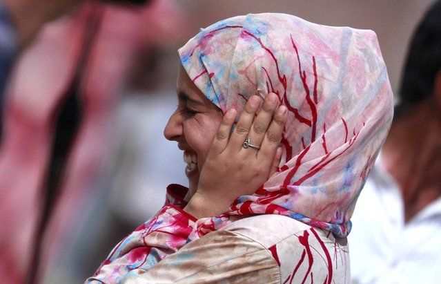 A Kashmiri girl reacts as a teargas shell fired by Indian security forces explodes during clashes after scrapping of the special constitutional status for Kashmir by the Indian government, in Srinagar, August 30, 2019. (Photo by Danish Ismail/Reuters)