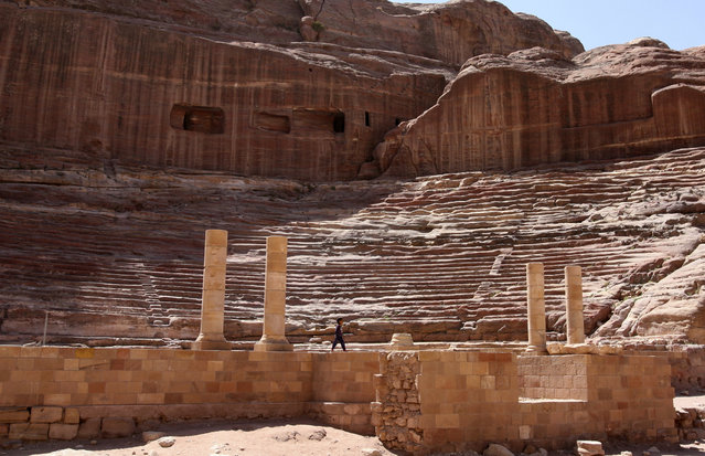 Petra: A child walks in the amphitheatre which was first constructed by the Nabataeans in the early 1st century AD and refurbished by the Romans soon after their conquest in 106 AD, in the ancient city of Petra April 7, 2008. (Photo by Erik de Castro/Reuters)