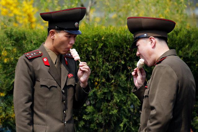 Soldiers enjoy ice-cream in Pyongyang, North Korea April 16, 2017. (Photo by Damir Sagolj/Reuters)