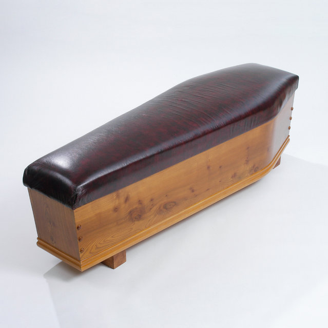 A coffin in the shape of a bench in a church. (Photo by Caters News Agency)