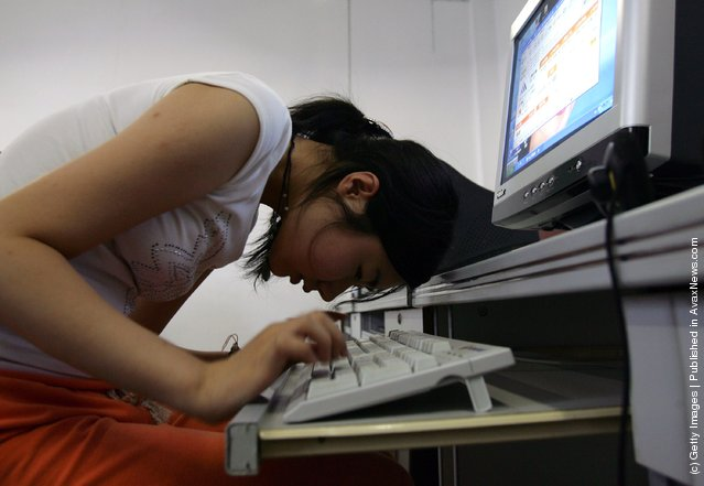 A student learns to surf the Internet at the Wuhan School for the Blind