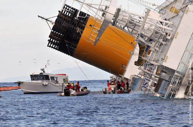 The cruise ship Costa Concordia lies stricken off the shore of the island of Giglio