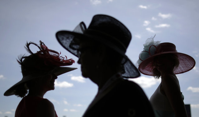 Women make their way to the grandstand before the 140th running of the Kentucky Derby horse race at Churchill Downs Saturday, May 3, 2014, in Louisville, Ky. (Photo by David Goldman/AP Photo)