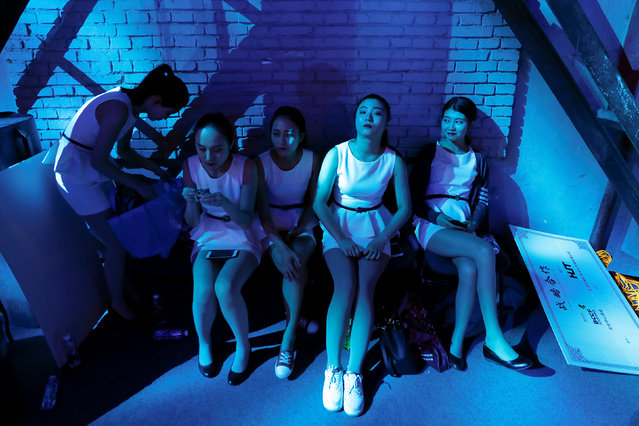 "Members of the staff wait for the start of the maiden press conference for China's all-girl ""boyband"" FFC-Acrush in Beijing, China April 28, 2017. Picture taken April, 28, 2017. (Photo by Damir Sagolj/Reuters)"