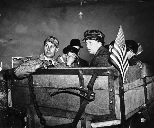 Mrs. Eleanor Roosevelt wears miner's hat as she rides mine car, at left Adolph Pacifico local President United Mine Workers during 1935 visit as first lady to a Bellaire, Ohio, Coal Mine on May 21, 1935. (Photo by AP Photo)