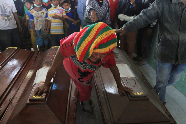 A woman mourns over the coffin of a relative after a deadly eruption of Mount Sinabung in Sukandebi village, Karo, North Sumatra, Indonesia May 22, 2016, in this photo taken by Antara Foto. (Photo by Irsan Mulyadi/Reuters/Antara Foto)