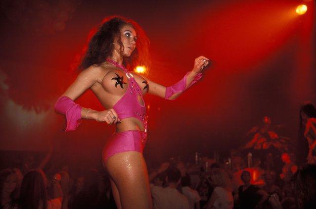 Go-go girl at Hollywood Club Disco, Tallinn, Estonia, Europe. (Photo by Ingolf Pompe/Alamy Stock Photos)