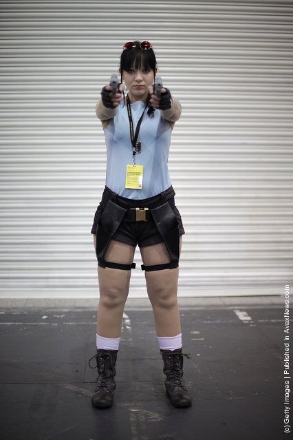 A visitor to the London Super Comic Convention dresses as Lara Croft at ExCel
