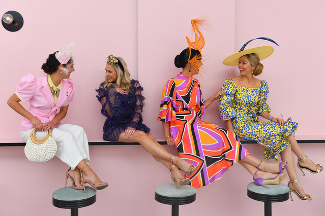 Fashions on the Field contestants pose for a photograph in the Park during Melbourne Cup Day, at Flemington Racecourse in Melbourne, Australia, Tuesday, November 5, 2019. (Photo by James Ross/AAP Image)