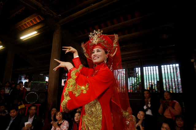 Medium Nguyen Bich Thuy performs during a Hau Dong ceremony at Kiep Bac temple in Hai Duong province in Vietnam, February 11, 2017. (Photo by Reuters/Kham)