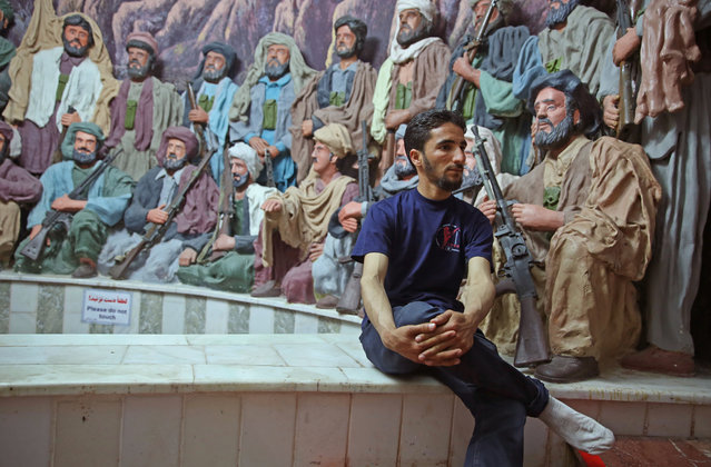 "In this Sunday, April 12, 2015 photo, a man looks at statues depicting a ""Mujahideen"" gathering, at the Jihad Museum, in Herat city, west of capital Kabul, Afghanistan. (Photo by Massoud Hossaini/AP Photo)"