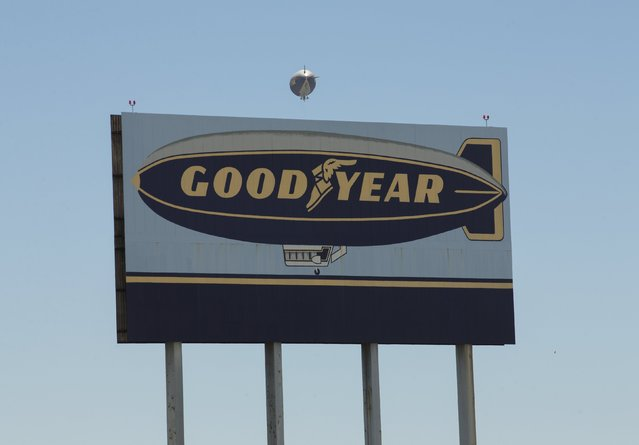 """The Goodyear blimp """"Spirit of America"""" floats past a highway billboard  sign in Carson, California August 5, 2015. (Photo by Mike Blake/Reuters)"""