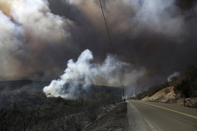 Smoke from the so-called Jerusalem Fire hovers above Morgan Valley Road in Lake County, California, August 12, 2015. (Photo by Robert Galbraith/Reuters)