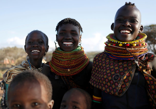 Young Turkana tribeswomen sing in a village near Baragoy, Kenya August 6, 2017. (Photo by Goran Tomasevic/Reuters)