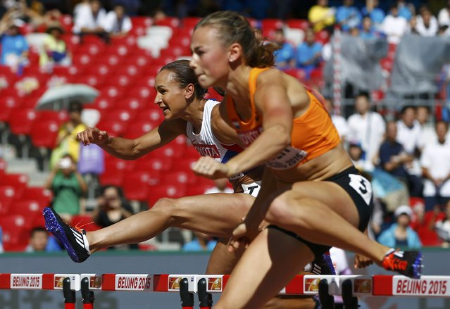 Jessiaca Ennis-Hill of Britain and Nadine Visser of the Netherlands (R) compete in the 100m hurdles event of the women's heptathlon during the 15th IAAF World Championships at the National Stadium in Beijing, China August 22, 2015. (Photo by Kai Pfaffenbach/Reuters)