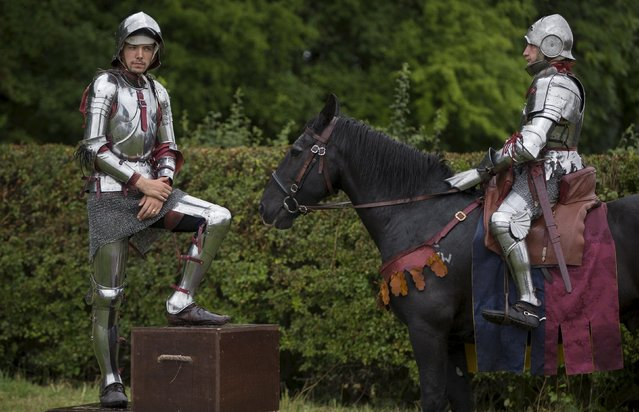 Historical re-enactors dress in armour are seen in a living history camp during an anniversary event for the Battle of Bosworth near Market Bosworth in central Britain, August 23, 2015. (Photo by Neil Hall/Reuters)