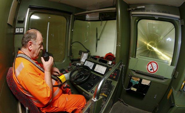 Engine driver Josef Kowatsch steers a train through the NEAT Gotthard Base Tunnel during a media visit near the town of Erstfeld August 24, 2015. (Photo by Arnd Wiegmann/Reuters)