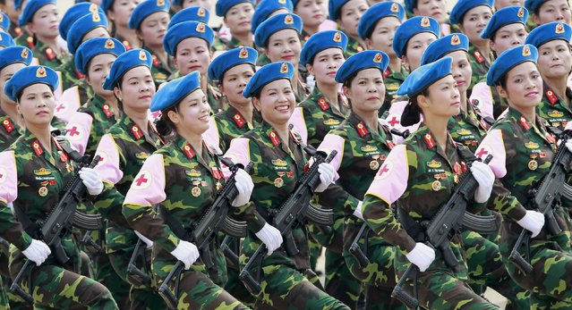 A Vietnamese female medical contingent from the military marches during a parade marking their 70th National Day at Ba Dinh square in Hanoi, Vietnam, September 2, 2015. (Photo by Reuters/Kham)