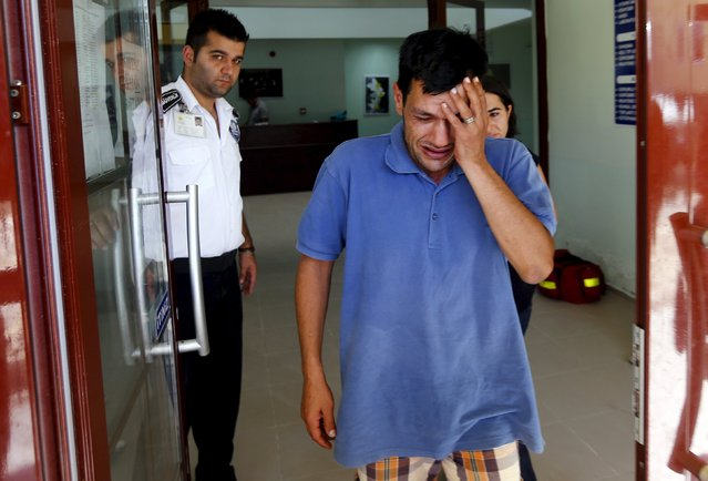 Abdullah Kurdi, father of three-year old Aylan Kurdi, cries as he leaves a morgue in Mugla, Turkey, September 3, 2015. The family of Aylan, a Syrian toddler whose body washed up on a Turkish beach, had been trying to emigrate to Canada after fleeing the war-torn town of Kobani, one of their relatives told a Canadian newspaper on Thursday. (Photo by Murad Sezer/Reuters)