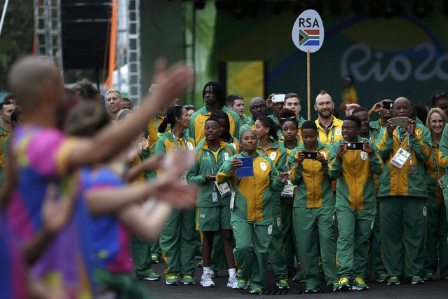 2016 Rio Olympics, Olympic Village on July 29, 2016. Members of South Africa watch their official welcome ceremony. (Photo by Edgard Garrido/Reuters)