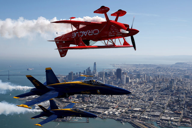 The U.S. Navy Blue Angels flight demonstration squadron and Team Oracle aerobatics pilot, Sean Tucker, fly over San Francisco Bay during a photo flight ahead of Fleet Week in San Francisco, California, U.S., October 5, 2017. (Photo by Stephen Lam/Reuters)