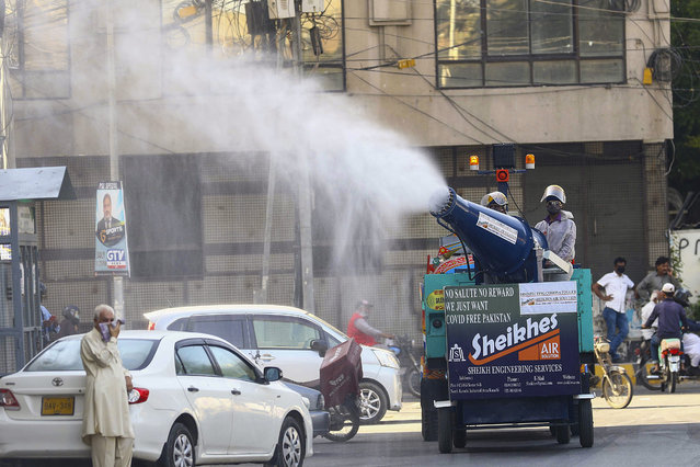 Workers spray disinfectant on a road during the Muslim holy month of Ramadan amid lockdown of the Sindh province due to the ongoing coronavirus COVID-19 disease pandemic in Karachi, Pakistan, 27 April 2020. Muslims around the world celebrate the holy month of Ramadan, by praying during the night time and abstaining from eating, drinking, and sexual acts during the period between sunrise and sunset. Ramadan is the ninth month in the Islamic calendar and it is believed that the revelation of the first verse in Koran was during its last 10 nights. (Photo by Shahzaib Akber/EPA/EFE/Rex Features/Shutterstock)