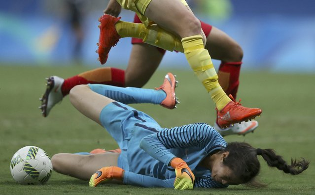2016 Rio Olympics, Soccer, Preliminary, Women's First Round, Group E China vs Sweden, Mane Garrincha Stadium, Brasilia, Brazil on August 9, 2016. Goalkeeper Lina Zhao (CHN)  of China makes a save in traffic against Sweden. (Photo by Ueslei Marcelino/Reuters)