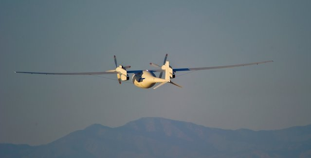 The new Boeing Phantom Eye unmanned drone, designed to stay airborne for days, travels on its first autonomous flight at the NASA Dryden Flight Research Center at Edwards Air Force Base, California, on June 1, 2012. The 28-minute flight began at 6:22 a.m. PDT as the liquid-hydrogen powered aircraft lifted off its launch cart. Phantom Eye climbed to an altitude of 4,080 feet and reached a cruising speed of 62 knots. (Photo by Robert Ferguson/AP Photo/Boeing)
