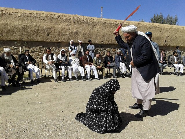 An Afghan judge hits a woman with a whip in front of a crowd in Ghor province, Afghanistan August 31, 2015. An Afghan man and woman found guilty of adultery received 100 lashes on Monday in front of a crowd who filmed their punishment, TV footage showed. (Photo by Reuters/Pajhwok News Agency)