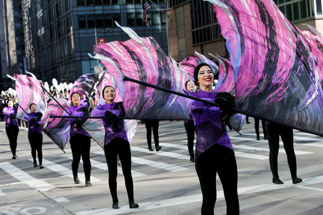 Performers march along 6th Avenue during the Macy's Thanksgiving Day Parade in Manhattan, New York, U.S., November 23, 2017. (Photo by Andrew Kelly/Reuters)