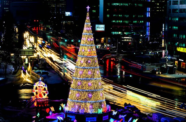 A Christmas tree stands in front of City Hall in Seoul, South Korea. (Photo by Lee Jin-man/Associated Press)
