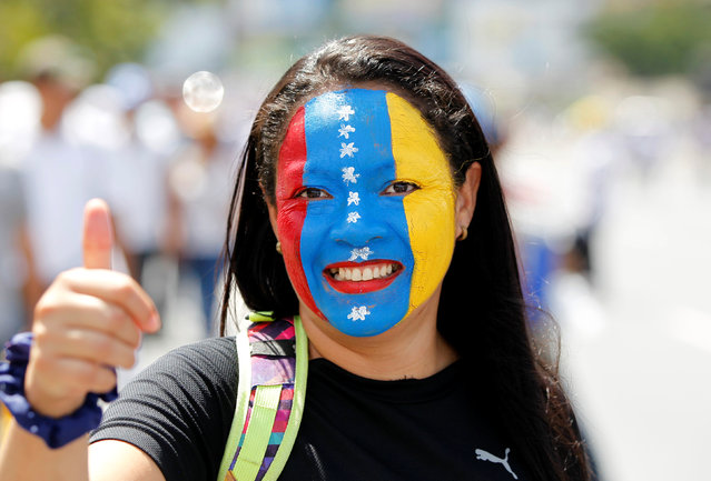 An opposition supporter gives a thumbs up while taking part in a rally to demand a referendum to remove Venezuela's President Nicolas Maduro in Caracas, Venezuela, September 1, 2016. (Photo by Christian Veron/Reuters)