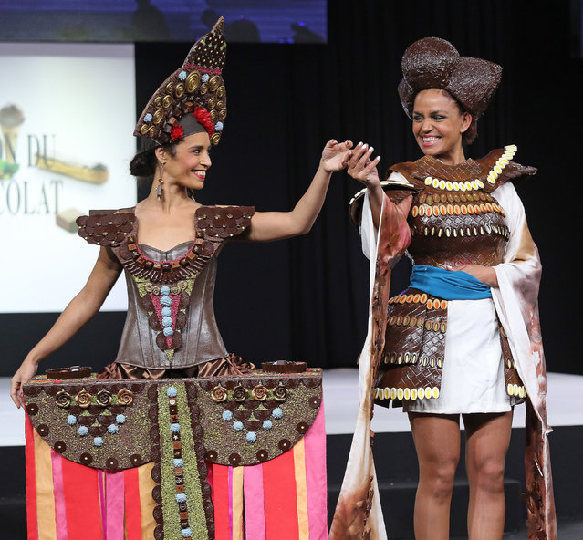 Models wear creations made with chocolate during a fashion show at the inauguration of the 20th annual Salon du Chocolat in Paris on October 28, 2014. (Photo by David Silpa/UPI)