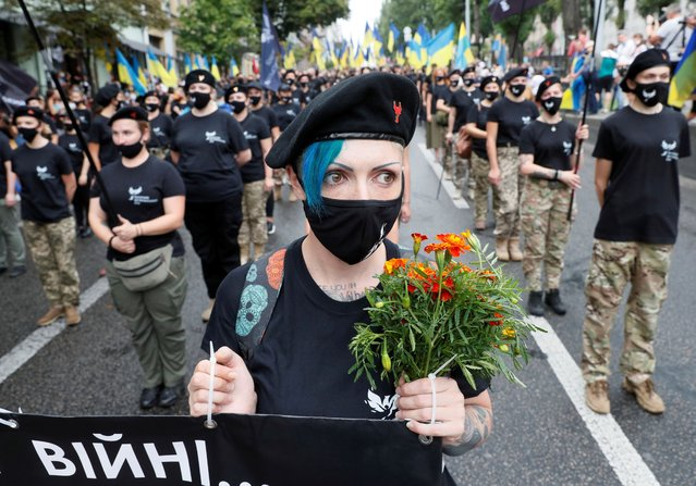 Members of the Women's veteran movement take part in the March of Defenders of Ukraine as part of Ukraine's Independence Day celebrations, in Kyiv, Ukraine on August 24, 2020. (Photo by Gleb Garanich/Reuters)