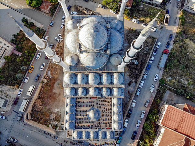 An aerial view of Kayiboyu Mosque is seen during Eid al-Adha prayer as people contain social distance due to coronavirus (Covid-19) pandemic in Bilecik, Turkey on July 31, 2020. (Photo by Tayyib Hosbas/Anadolu Agency via Getty Images)