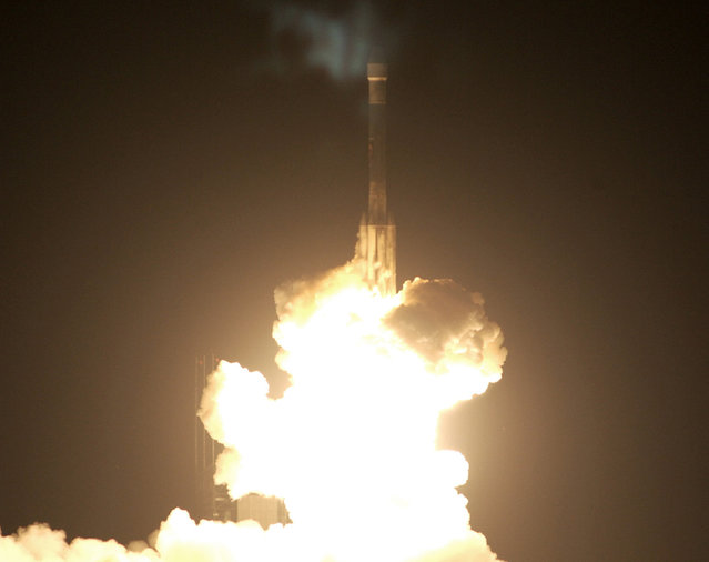 On July 7, 2003, at Launch Complex 17-B, Cape Canaveral, Florida, a Delta II Heavy launch vehicle lifts off, carrying the rover Opportunity towards Mars, at 11:18 p.m. EDT. (Photo by NASA/The Atlantic)