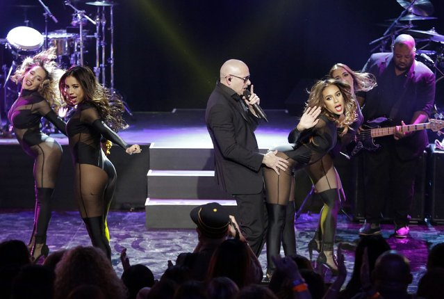 """Rapper Pitbull performs on the Honda Stage at the iHeartRadio Theater Los Angeles in Burbank, California November 19, 2014. The event featured a discussion with Pitbull about his eighth studio album """"Globalization"""". (Photo by Jason Redmond/Reuters)"""