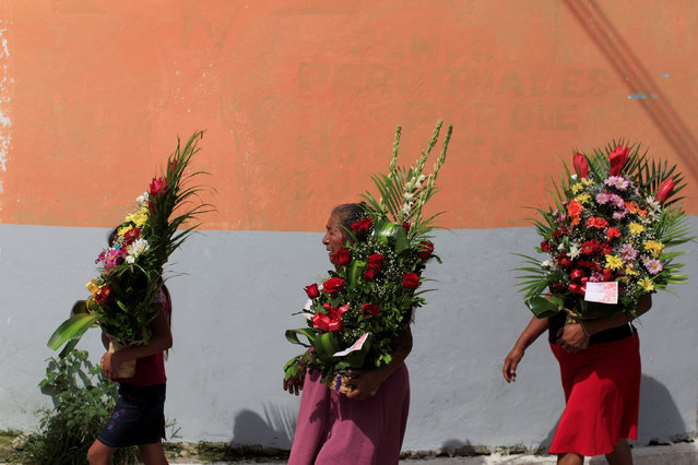 People participate in a procession during festivities in honour of St. Michael the Archangel in San Miguel Tepezontes, El Salvador September 28, 2016. (Photo by Jose Cabezas/Reuters)