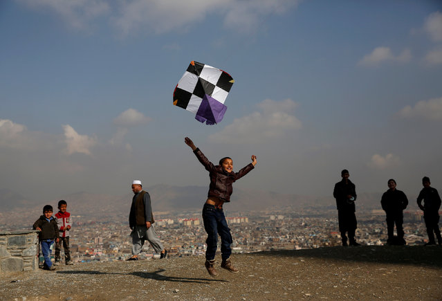 An Afghan boy launches a kite as he plays on top of a hill in Kabul, Afghanistan February 21, 2018. (Photo by Mohammad Ismail/Reuters)