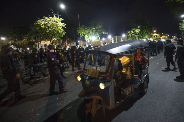 Riot police move in to disperse pro-democracy protesters outside the Government House in Bangkok, Thailand, Thursday, October 15, 2020. (Photo by Wason Wanichakorn/AP Photo)