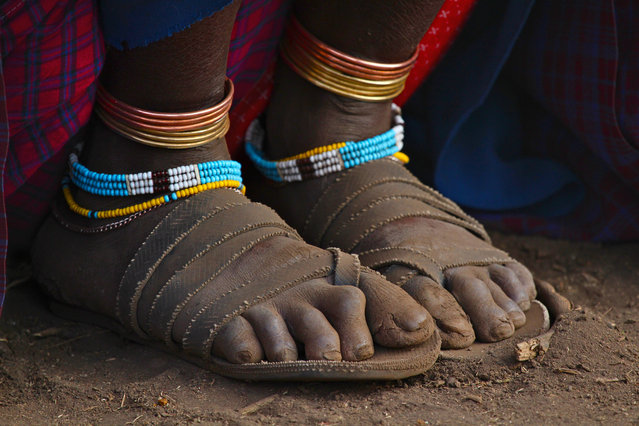 """The feet of a Maasai woman, taken in a Maasai village in northern Tanzania"". (Photo by Phil Burnside/The Guardian)"