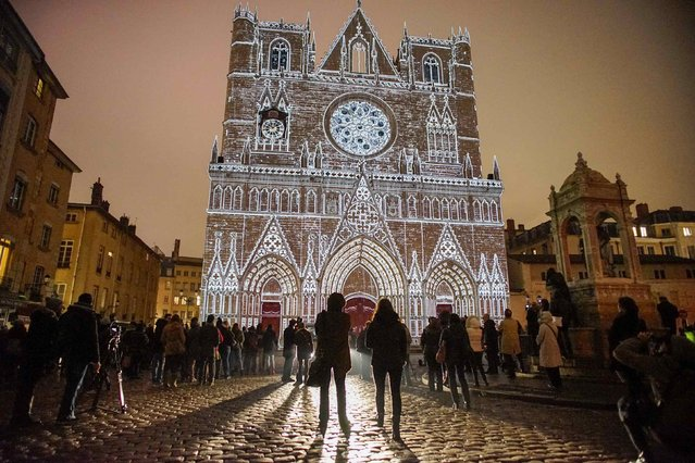 View of Color or Not installation by artist Yves Moreaux at the Saint-Jean Cathedral during the rehearsal for the Festival of Lights in central Lyon late in the night December 4, 2014. The Festival of Lights (Fetes des Lumieres), with designers from all over the world, is one of Lyon's most famous Festivals to date and will run from December 5 to December 8, 2014. (Photo by Robert Pratta/Reuters)