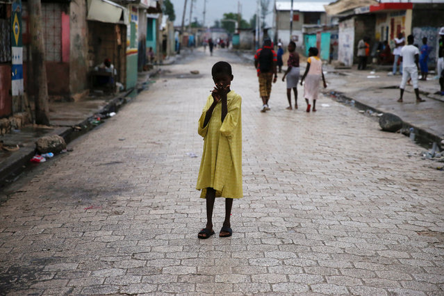 A child stands on a street, after Hurricane Matthew passes Cite-Soleil in Port-au-Prince, Haiti, October 5, 2016. (Photo by Carlos Garcia Rawlins/Reuters)