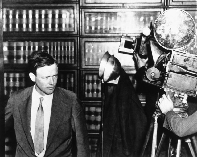 Charles A. Lindbergh poses for a battery of movie cameras in the library of the Hunterdon County Courthouse at Flemington, NJ, on January 3, 1935 before entering the courtroom to attend the trial of Bruno Hauptmann, accused of slaying the aviator's child. (Photo by AP Photo)