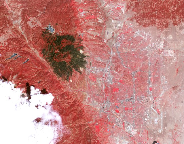 The burn scar from the Waldo Canyon Fire is pictured in this July 4, 2012 handout photo from an Advanced Spaceborne Thermal Emission and Reflection Radiometer (ASTER) on the Terra satellite by NASA, in Colorado Springs, Denver. (Photo by Reuters/NASA)