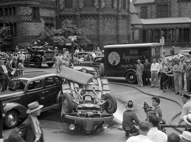 Overturned car, 1940s. (Photo by Leslie Jones)