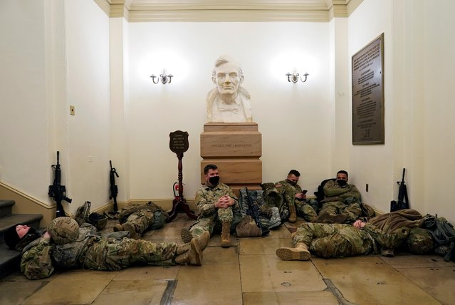 National Guard members sleep, before Democrats begin debating one article of impeachment against U.S. President Donald Trump at the U.S. Capitol, in Washington, U.S., January 13, 2021. (Photo by Joshua Roberts/Reuters)