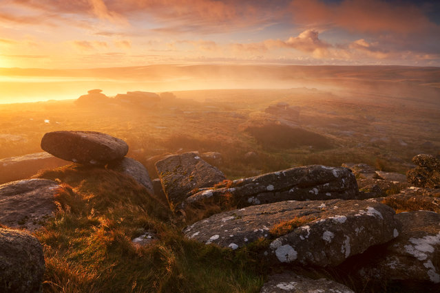 Sunrise over a moor viewed from Littaford Tor, Dartmoor, UK, 2016. Autumn visits the windswept moors and granite tors of Dartmoor earlier than the rest of the south-west. While there aren't many trees here, autumn shades appear in golden ferns and tan heather. Littaford Tors, near Two Bridges and a mile from Princetown, is a short walk and can be combined with a visit to the adjacent Wistman's Wood. (Photo by Stuart Holmes)